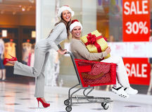 Santa Christmas couple with a gift. Royalty Free Stock Image