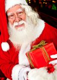 Santa with a Christmas gift Stock Photo