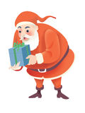 Santa and christmas gift. Santa in a gesture to hand over a boxed gift Stock Photography