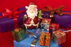 Santa with Christmas gifts. Santa surrounded with christmas gifts Stock Images