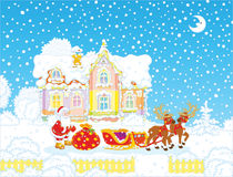 Santa with Christmas gifts and sledge Stock Image