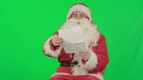 Santa with Christmas letter or wish list on a stock footage