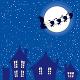 Santa Christmas Night. Illustration of abstract background of Christmas night with Santa Claus and reindeer sleigh flying through sky Stock Photo