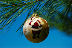Santa Christmas Ornament. Santa Claus Christmas ornament hanging on a pine tree branch royalty free stock photos