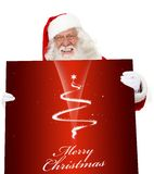 Santa with a Christmas poster Stock Image