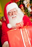 Santa with a Christmas present Royalty Free Stock Images