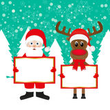 Santa and Christmas reindeer Royalty Free Stock Photography