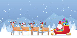 Santa and Christmas Reindeer on Snow Royalty Free Stock Photo