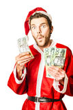 Santa at Christmas sale in Australia. Isolated photo of a surprised santa holding Australian money while celebrating savings at christmas store sale in Australia Royalty Free Stock Photos