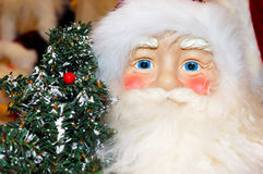 Santa with a Christmas Tree Stock Photos