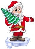 Santa with Christmas tree on iceberg Royalty Free Stock Image