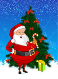 Santa Christmas Tree Presents and a Candy Royalty Free Stock Image