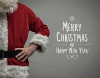 Santa and Christmas wishes. Confident Santa Claus posing with arms akimbo close up and Christmas wishes royalty free stock photography