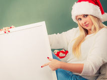 Santa christmas woman holding empty board Royalty Free Stock Photos