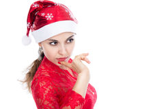 Santa christmas woman looking to the side thinking. Stock Image
