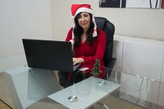 Santa christmas woman online shopping Royalty Free Stock Images