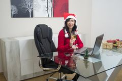 Santa christmas woman online shopping Royalty Free Stock Photos