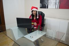 Santa christmas woman online shopping Stock Image