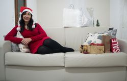 Santa christmas woman relaxing on sofa Stock Image