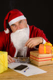 Santa cigarette break Stock Photography