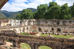 Santa Clara convent ruin, Antigua, Guatemala. Gardens and arched walls in Convento de Santa Clara, a Catholic convent in Antigua, Guatemala. Destroyed by an stock images