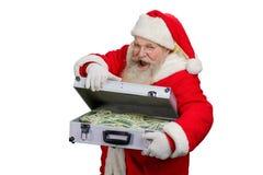 Santa Claus öppningsresväska med pengar Royaltyfri Foto