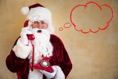 Santa Claus говоря на телефоне Стоковые Фото