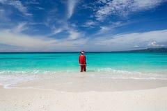 Santa Claus идет в океан Стоковые Фотографии RF