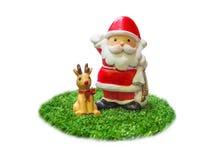 Santa Claus и северный олень Стоковые Фото