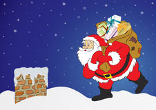 Santa Claus. Christmas night, Santa Claus with presents in a chimney Stock Photography