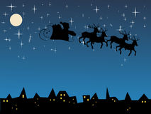Santa claus. Vector illustration of a sligh over the town Royalty Free Stock Image