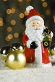 Santa Claus. And christmas bauble with lights in background Stock Photo