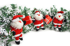 Santa Claus Christmas garland. Three funny Santa Clauses with red gift boxes on white background Stock Images