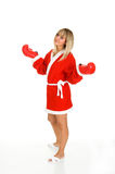 Santa Claus. Young blond girl in Santa Claus dress with boxing gloves Royalty Free Stock Images