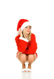 Santa Claus. Young blond girl in Santa Claus dress. White background Royalty Free Stock Image