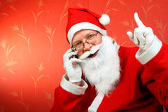 Santa claus. With mobile phone stock photo