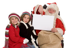 Santa Claus. With two lucky children Stock Images