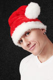 Santa Claus. Young man in the cap Santa Claus Royalty Free Stock Photos
