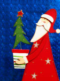 Santa Claus. On blue background - Merry Christmas Royalty Free Stock Images