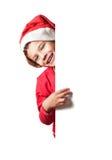 Santa Claus. Child as Santa Claus holding a white blank sign Stock Photo