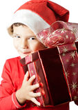 Santa Claus. Child as Santa Claus smiling and holding a gift Stock Photography
