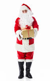 Santa Claus. Handed a gift on a white background Royalty Free Stock Photo