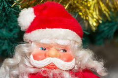 Santa Claus. Toy Santa Claus in a red cap with a Christmas tree Stock Photography
