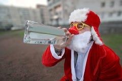 Santa claus. Drinking santa claus in sity Royalty Free Stock Photos