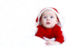 Santa Claus. A small child lying on a white background in the costume of Santa Claus stock photography