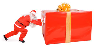Santa Claus. Pushing big package  on white background Royalty Free Stock Images