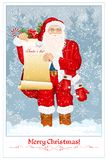 Santa Claus. With Santa's list and big sack with presents Royalty Free Stock Images
