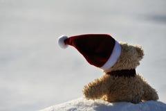 Santa Claus. Teddy as Santa Claus in the snow Stock Photos