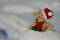 Santa Claus. Teddy as Santa Claus in the snow Royalty Free Stock Images