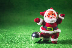 Santa Claus. Santa Claus with silver ball on green background Stock Photography